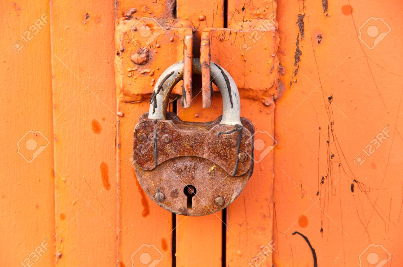 Background rusty gate are closed on the lock Stock Photo - 6660751