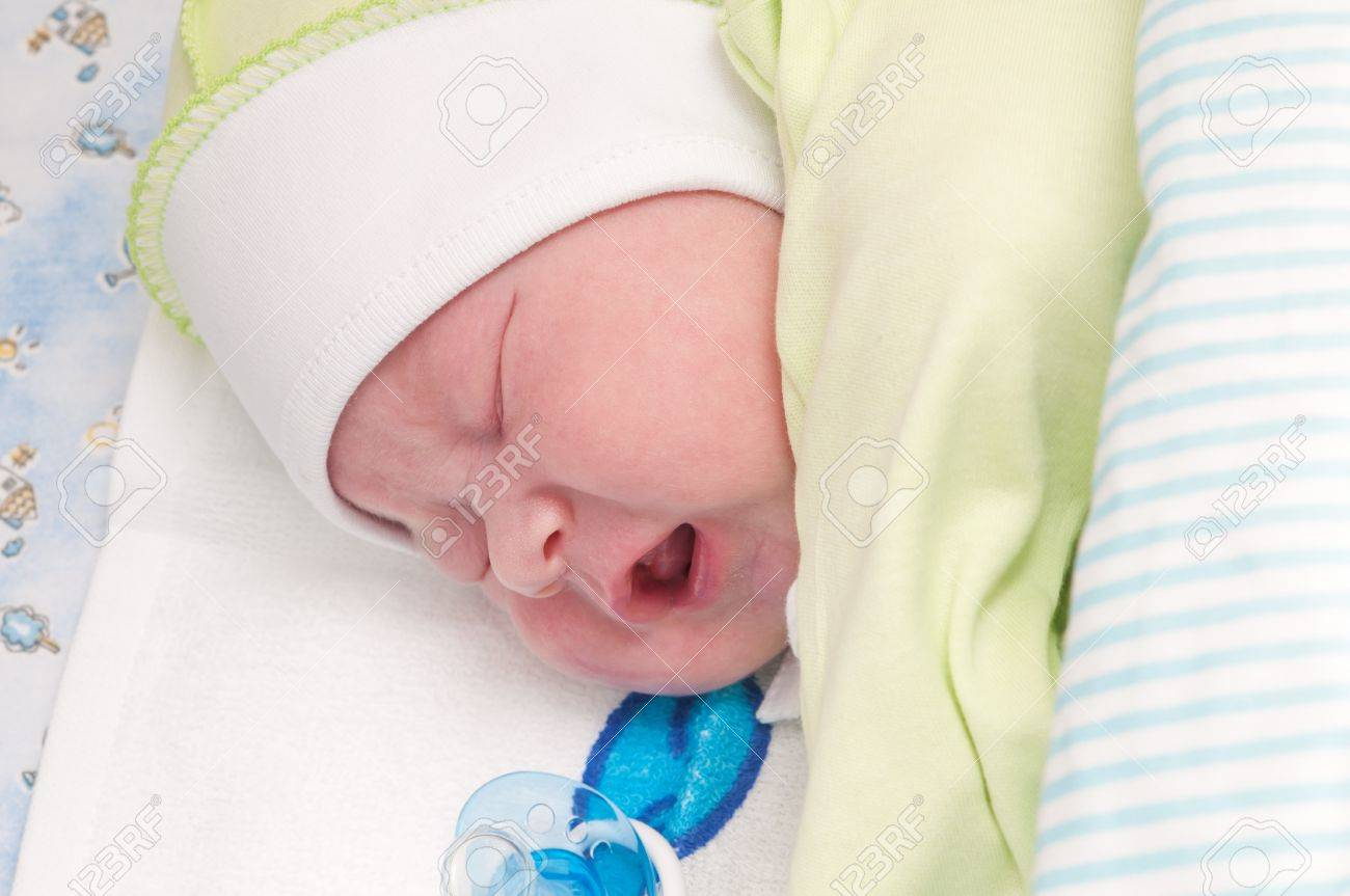 little newborn baby sleeps with his mouth open Stock Photo - 11222578