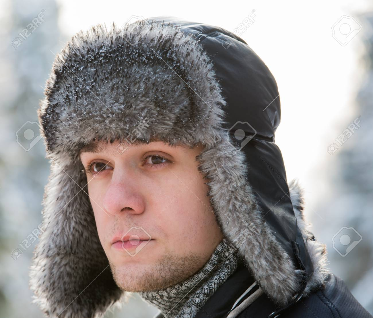 a man in a fur winter hat with ear flaps Stock Photo - 17543420 251f07735b3