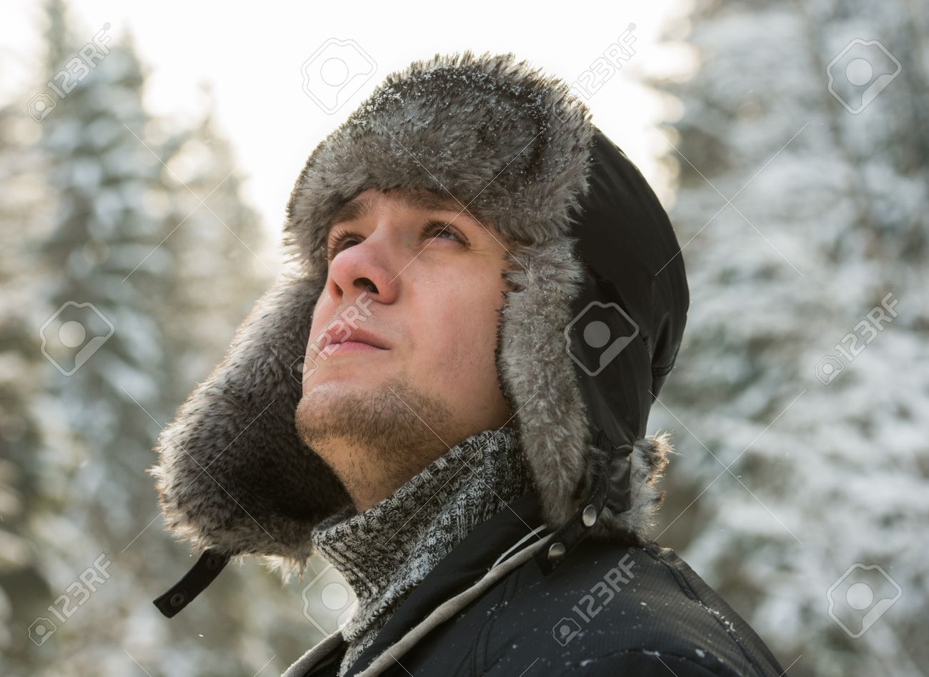 dcb585f9e79 a man in a fur winter hat with ear flaps Stock Photo - 17543416