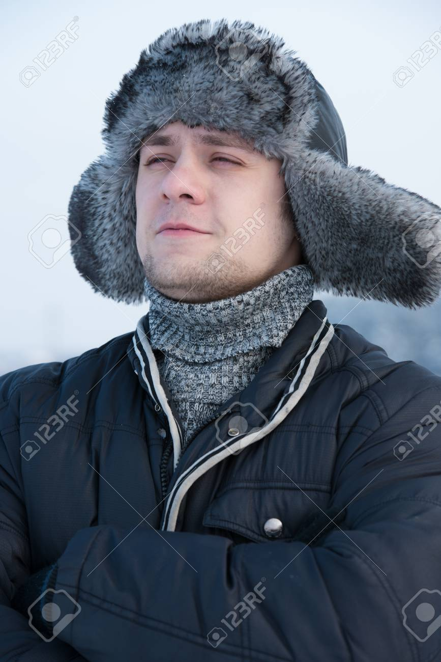 a man in a fur winter hat with ear flaps Stock Photo - 17601169 2d3879b95dc