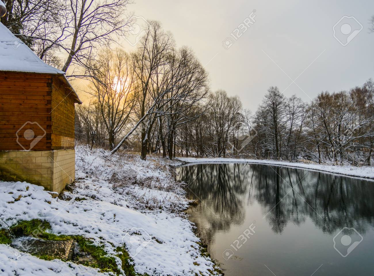 landscape is not still pond with snowy shore Stock Photo - 24433533