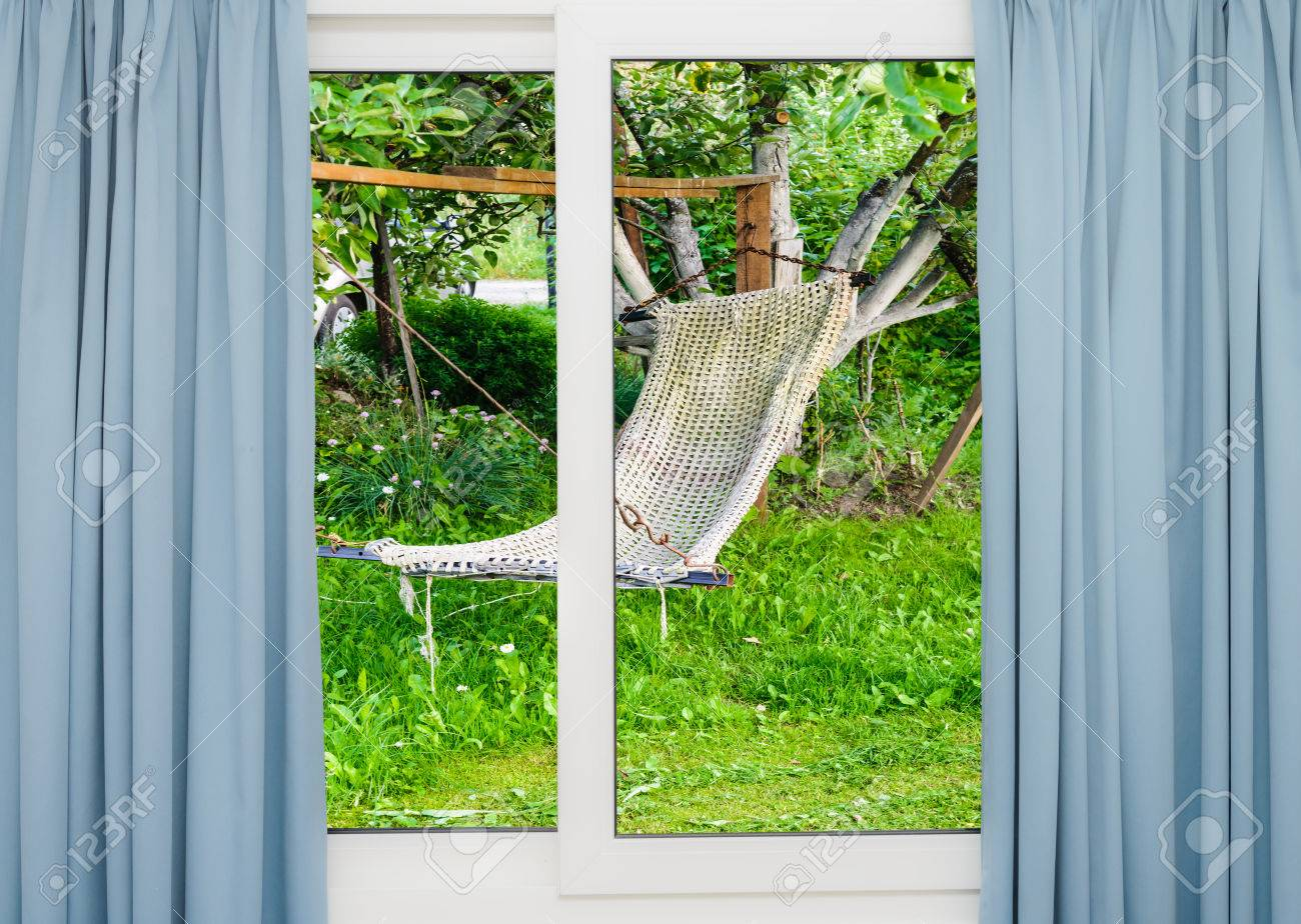 Stock Photo   View From The Window With The Curtains Of The Garden With A  Hammock