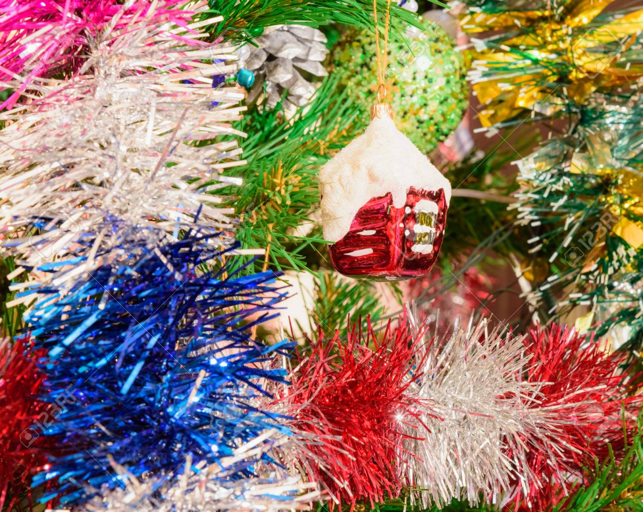 Christmas Tree Decorated With Toys Tinsel Garland Background