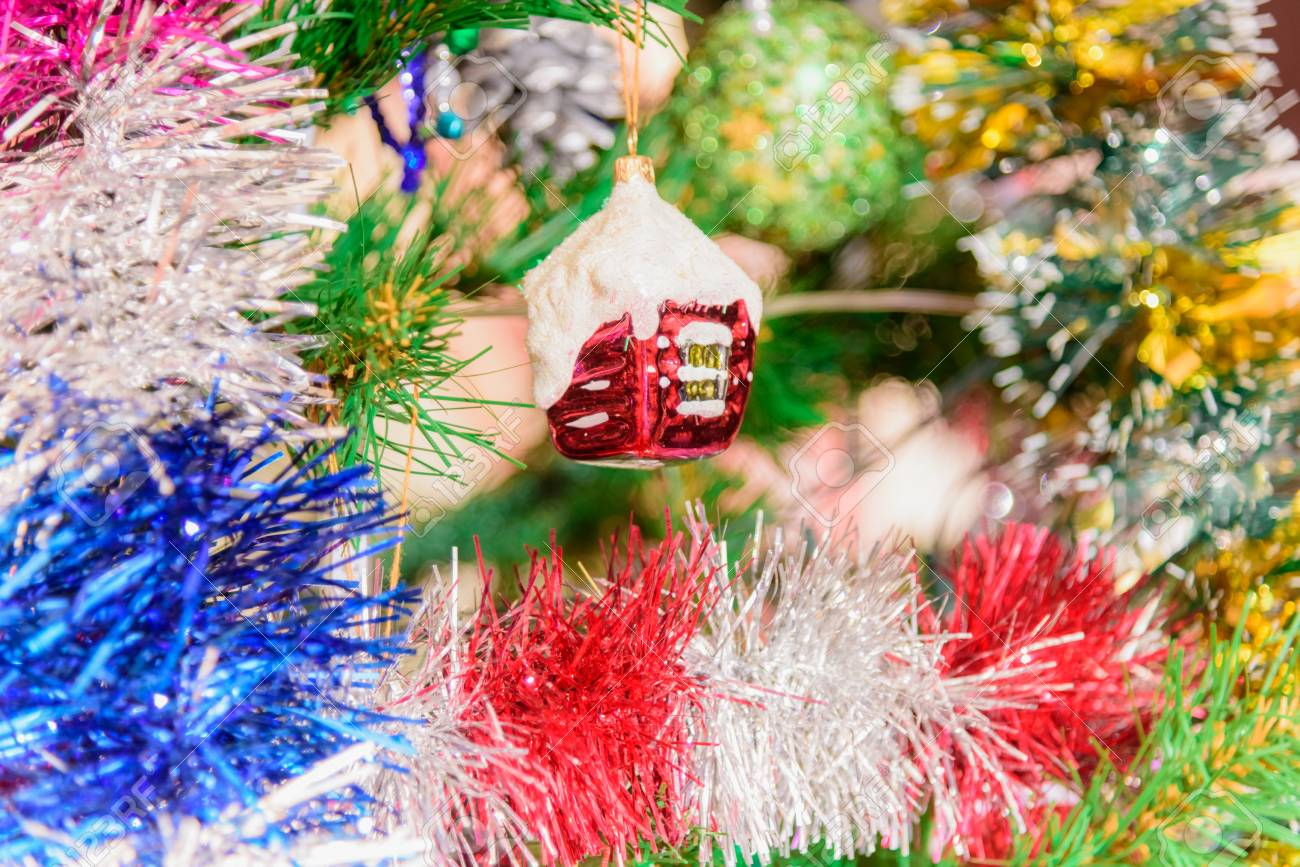 Christmas tree decorated with toys tinsel garland background stock