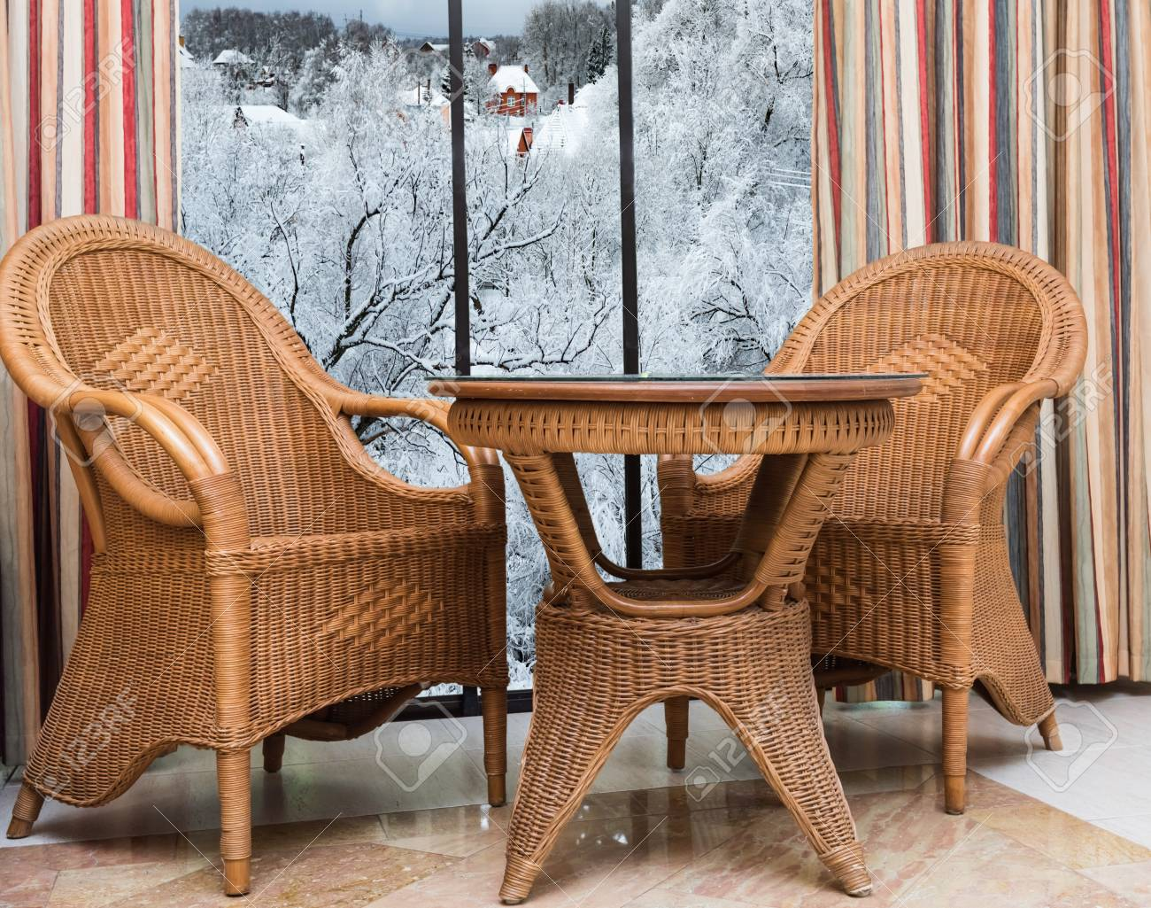 Terrific Wicker Furniture Rattan Table Two Chairs Near The Window With Beutiful Home Inspiration Aditmahrainfo