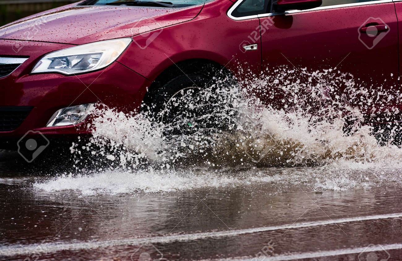 motion car rain big puddle of water spray from the wheels - 151733367