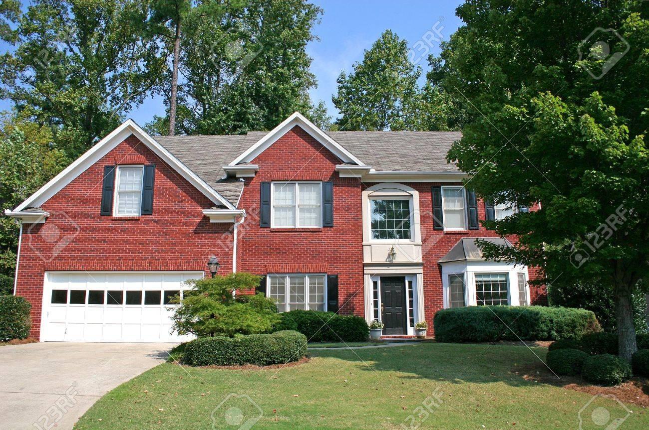 A nice brick house against a blue sky Stock Photo - 557913