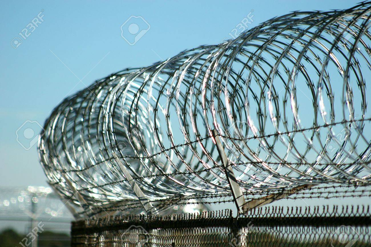 Razor Wire Atop Security Fence At Military Base Stock Photo, Picture ...
