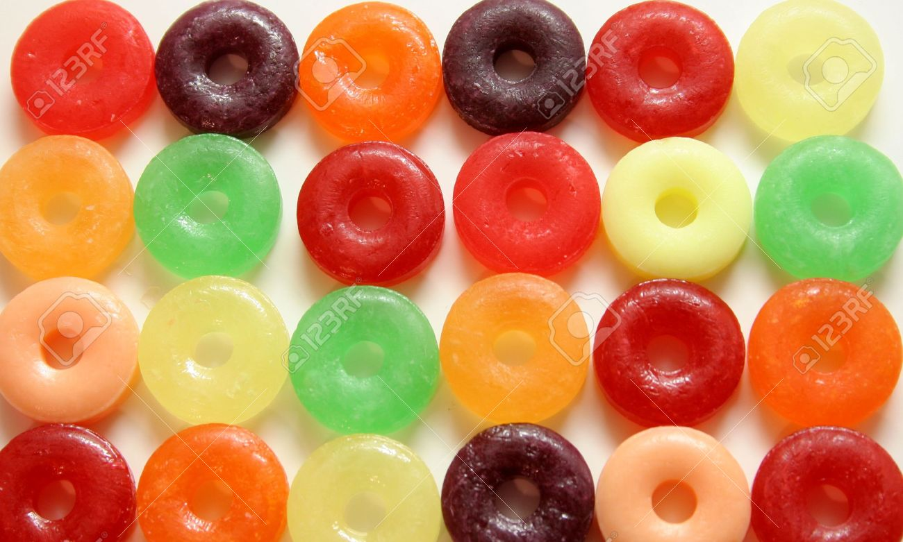 Colorful round candies with hole in middle on white background Stock Photo - 707637