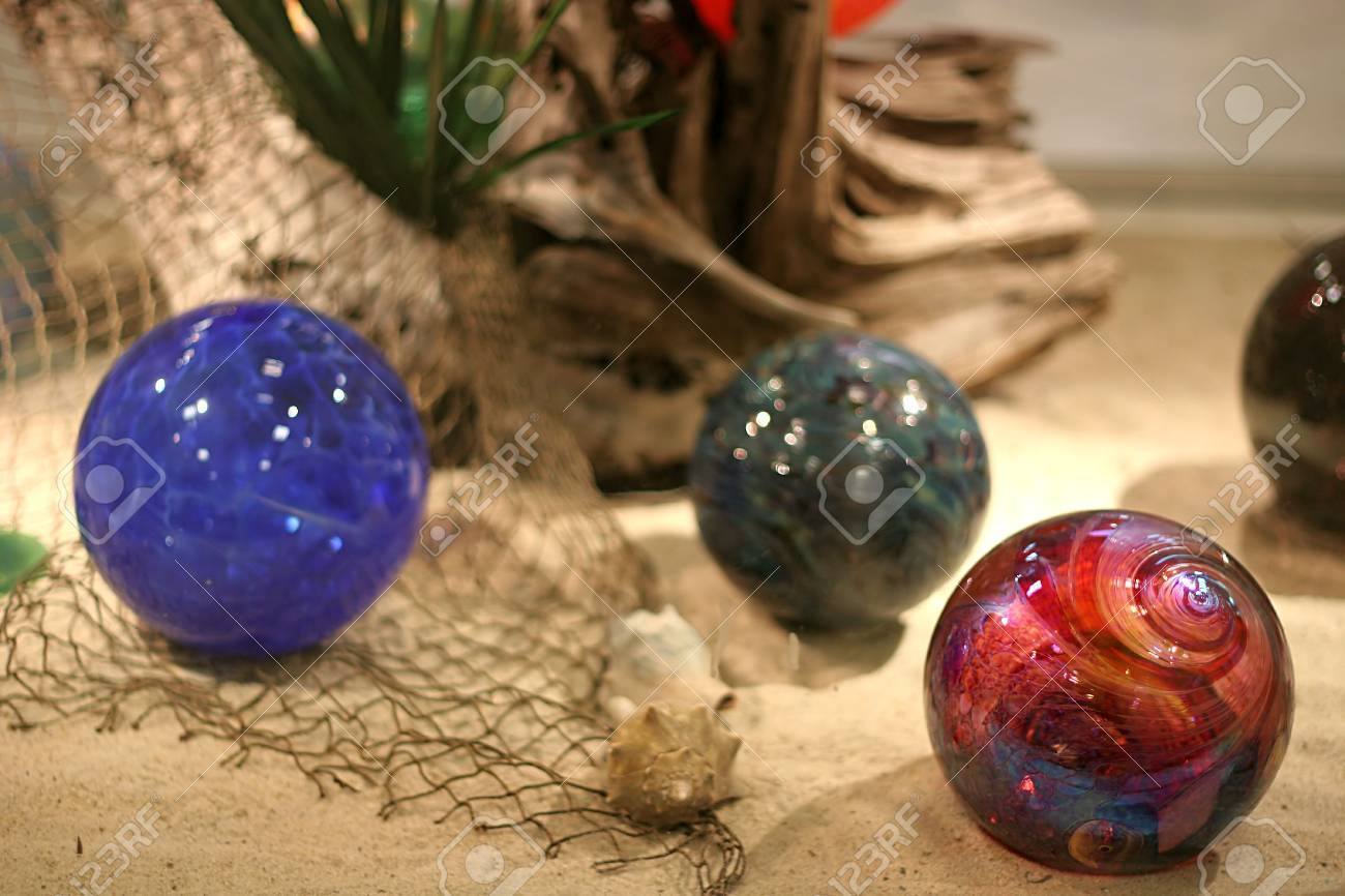 Christmas ornament display case - Colorful Orbs In Glass Display Case Stock Photo 727344