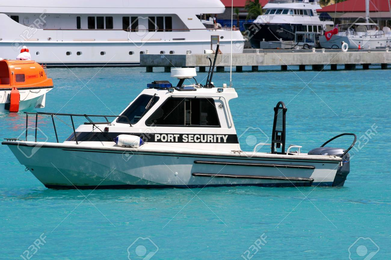 Port security motor boat speeding across the bay Stock Photo - 858141