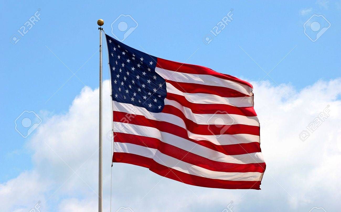 Large red white and blue american flag blowing in the wind Stock Photo - 901149