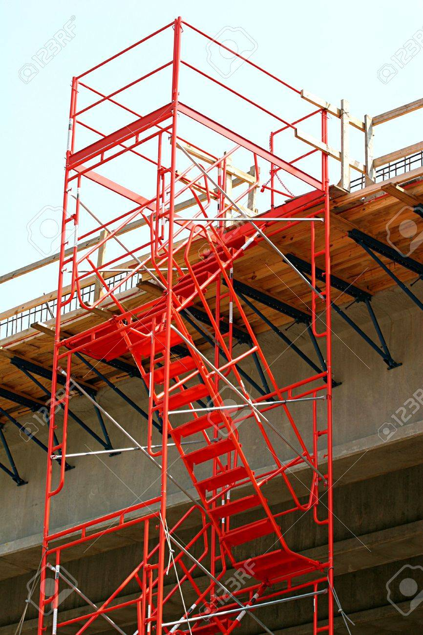 Steel Orange Stairs And Scaffolding On A Bridge Construction Stock Photo    908071