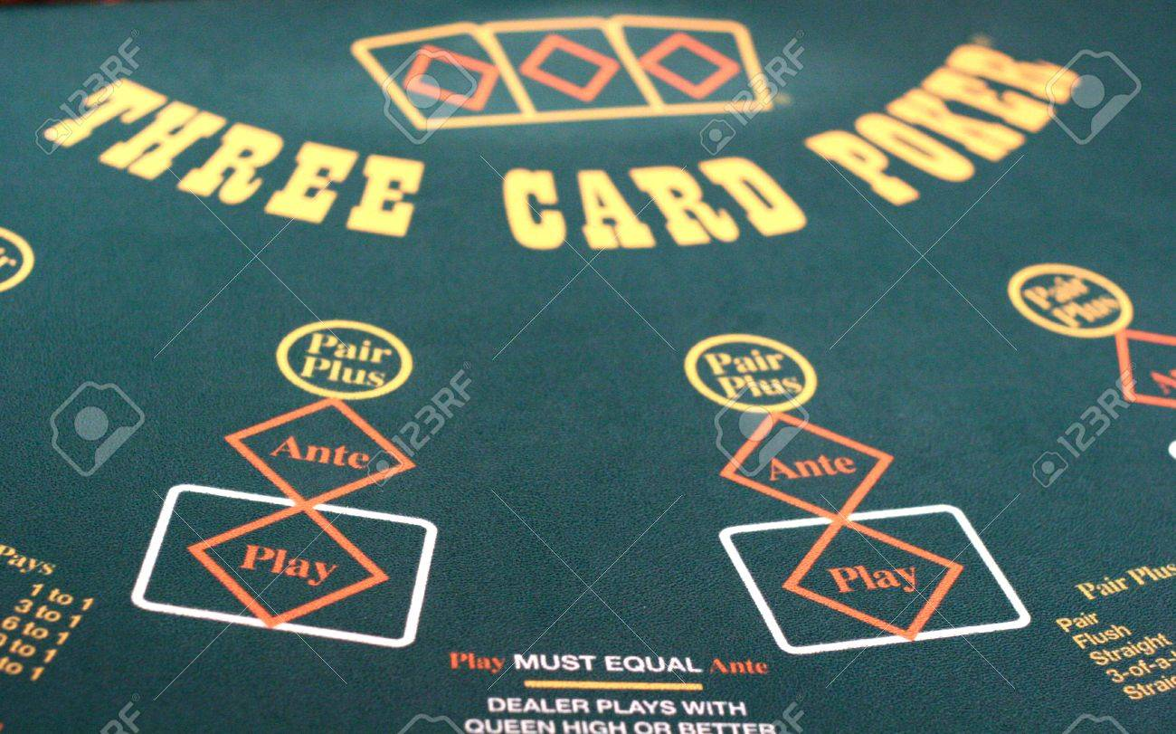 Close Up Of A Green Felt Gambling Table For Three Card Poker