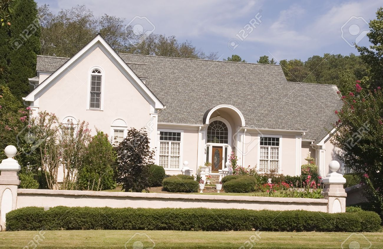 A nice pink and white stucco house stock photo 1944577