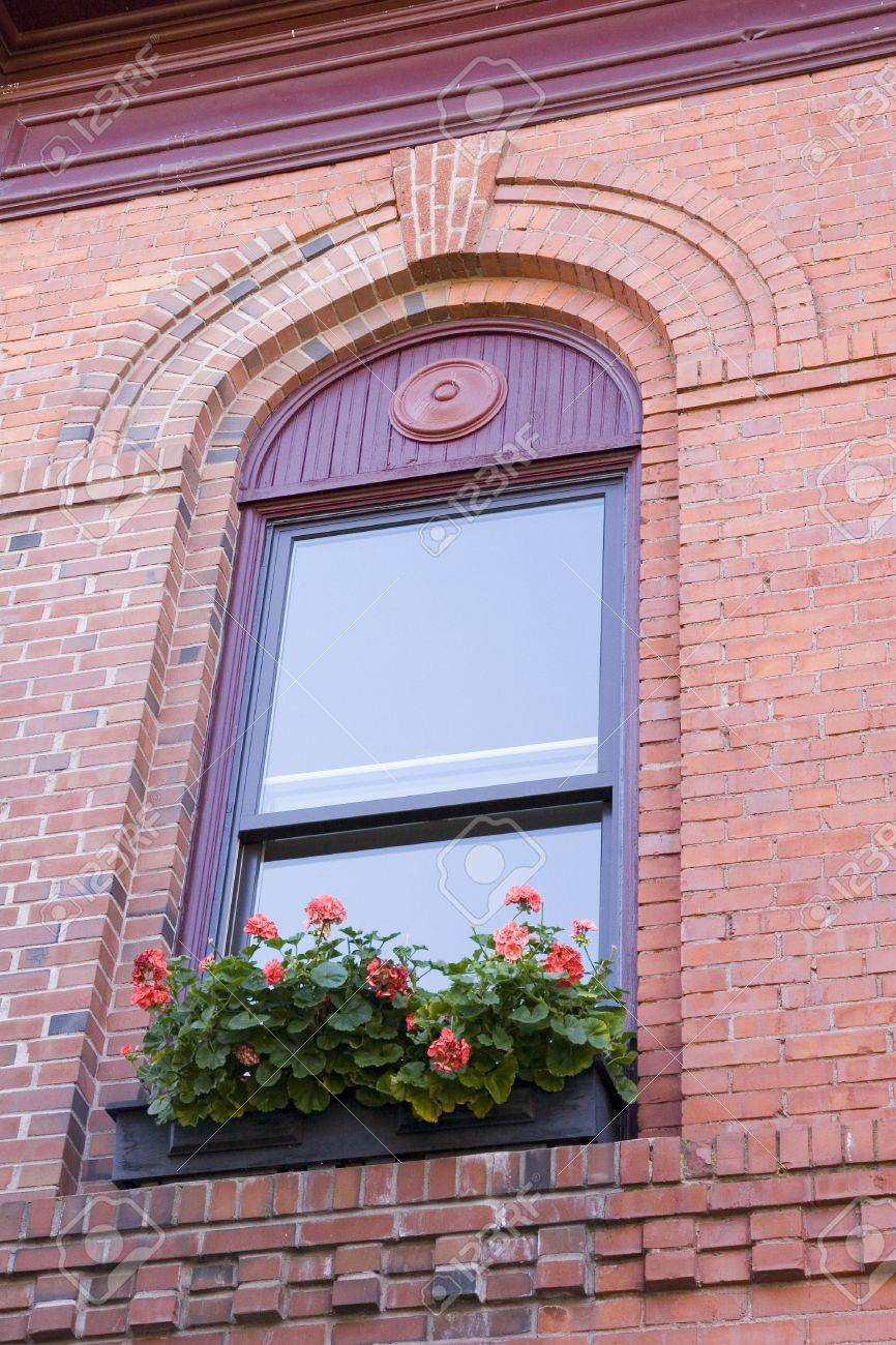 An Old Brick Apartment Building With Flower Boxes In Windows Stock Photo 2009314