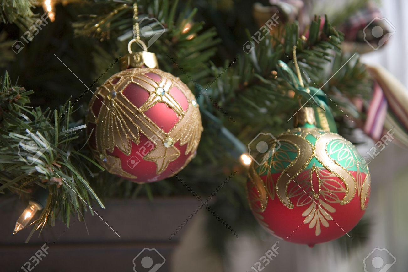 Gold and red ornaments - Red Green And Gold Ornaments On A Custom Christmas Tree Stock Photo 2180249