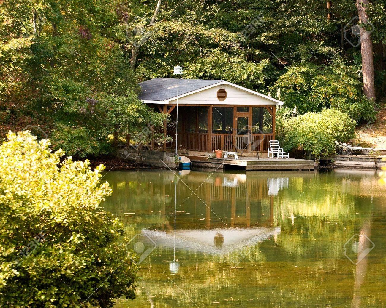 a nice house and boathouse on a placid lake Stock Photo - 3877950