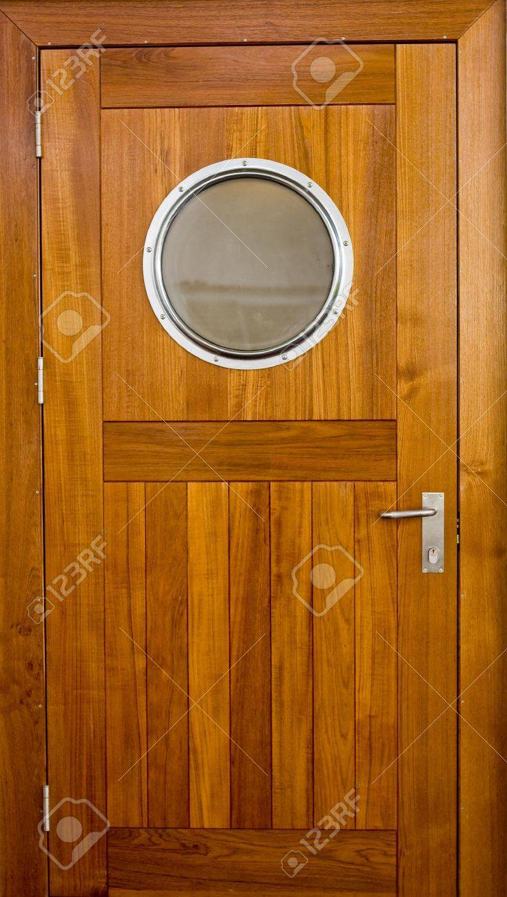 Stock Photo - Wooden door with a porthole on a ship & Wooden Door With A Porthole On A Ship Stock Photo Picture And ...