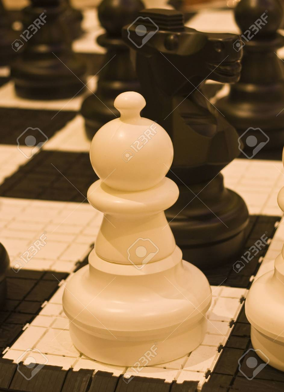 A white pawn in a chess game Stock Photo - 4678690