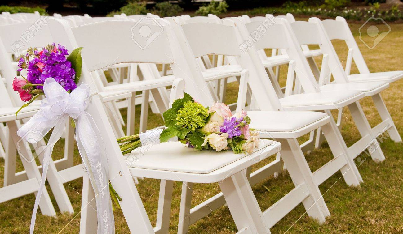 White Folding Chairs At An Outdoor Wedding With Flowers Stock Photo Picture And Royalty Free Image Image 5764629