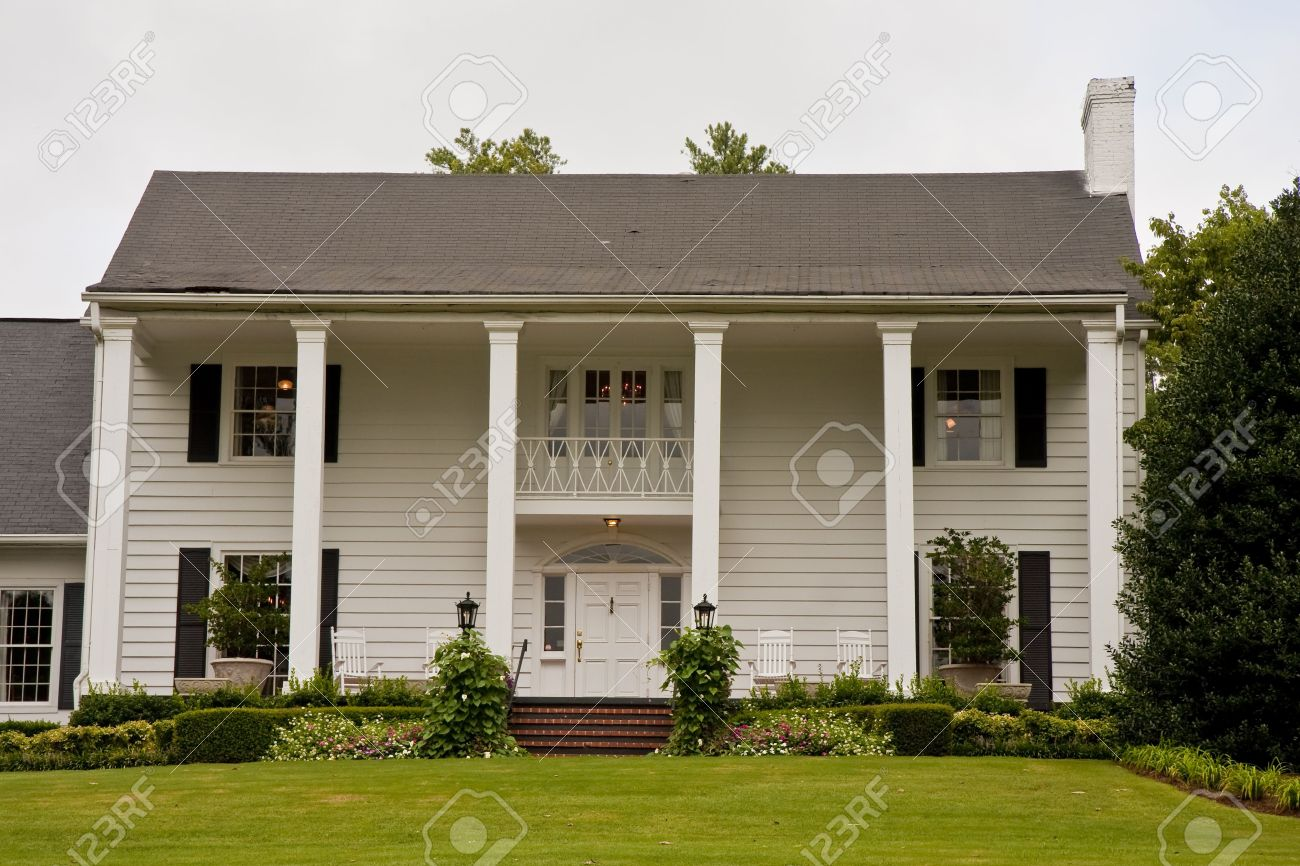 An old white colonial house with columns Stock Photo - 5826323