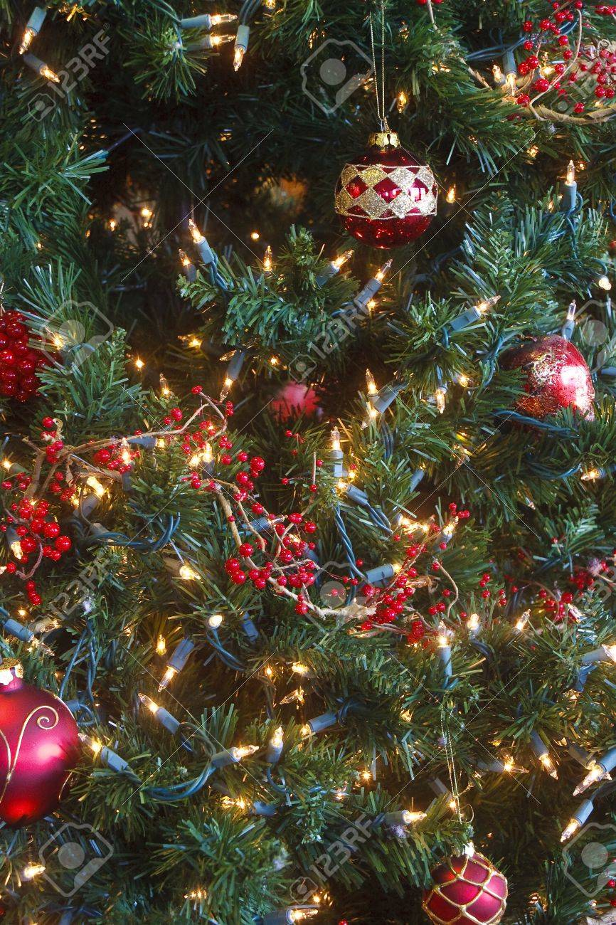 a decorated christmas tree with white lights and red berries stock photo 9060255