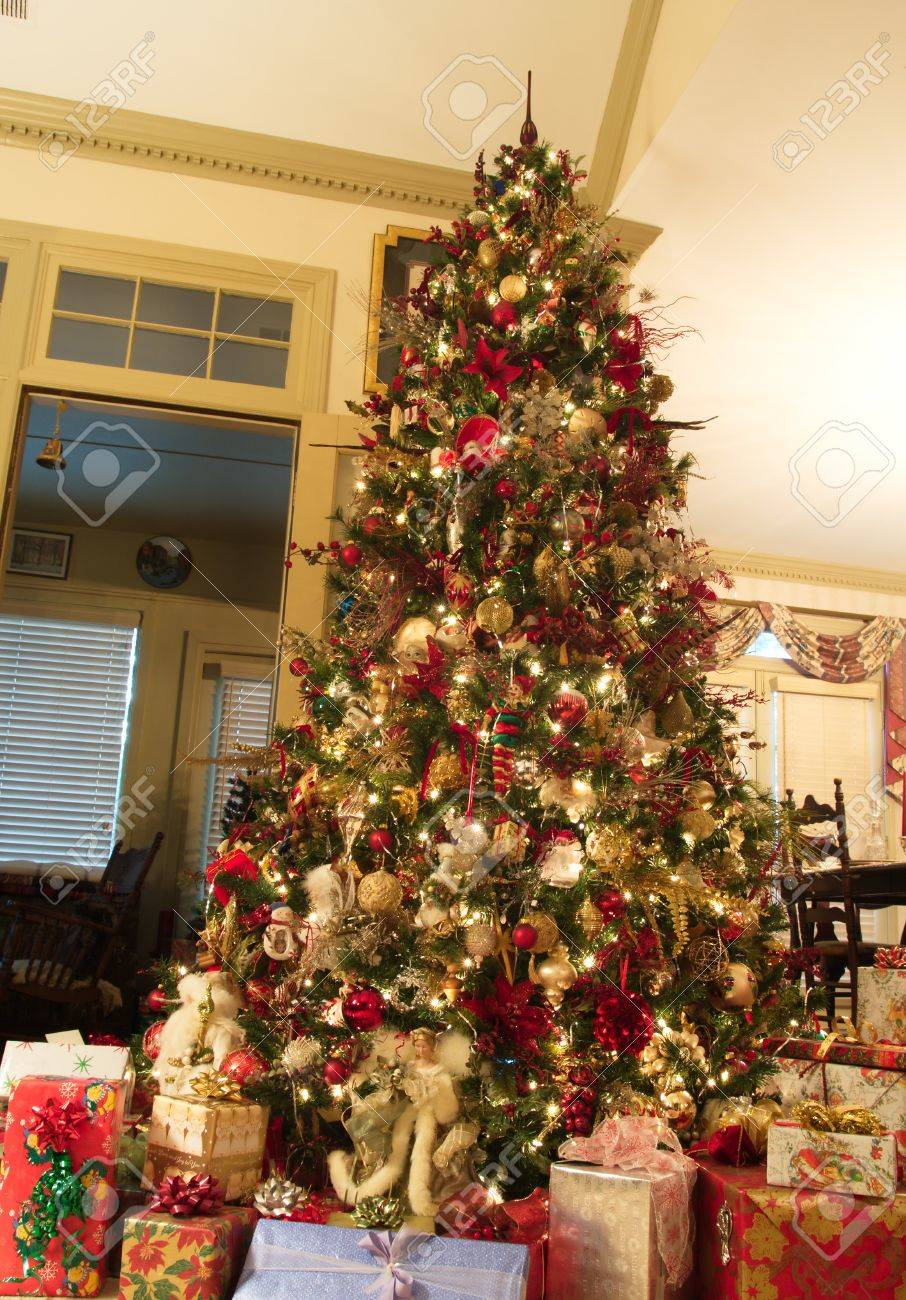 A Custom Decorated Christmas Tree With Presents On The Floor Stock