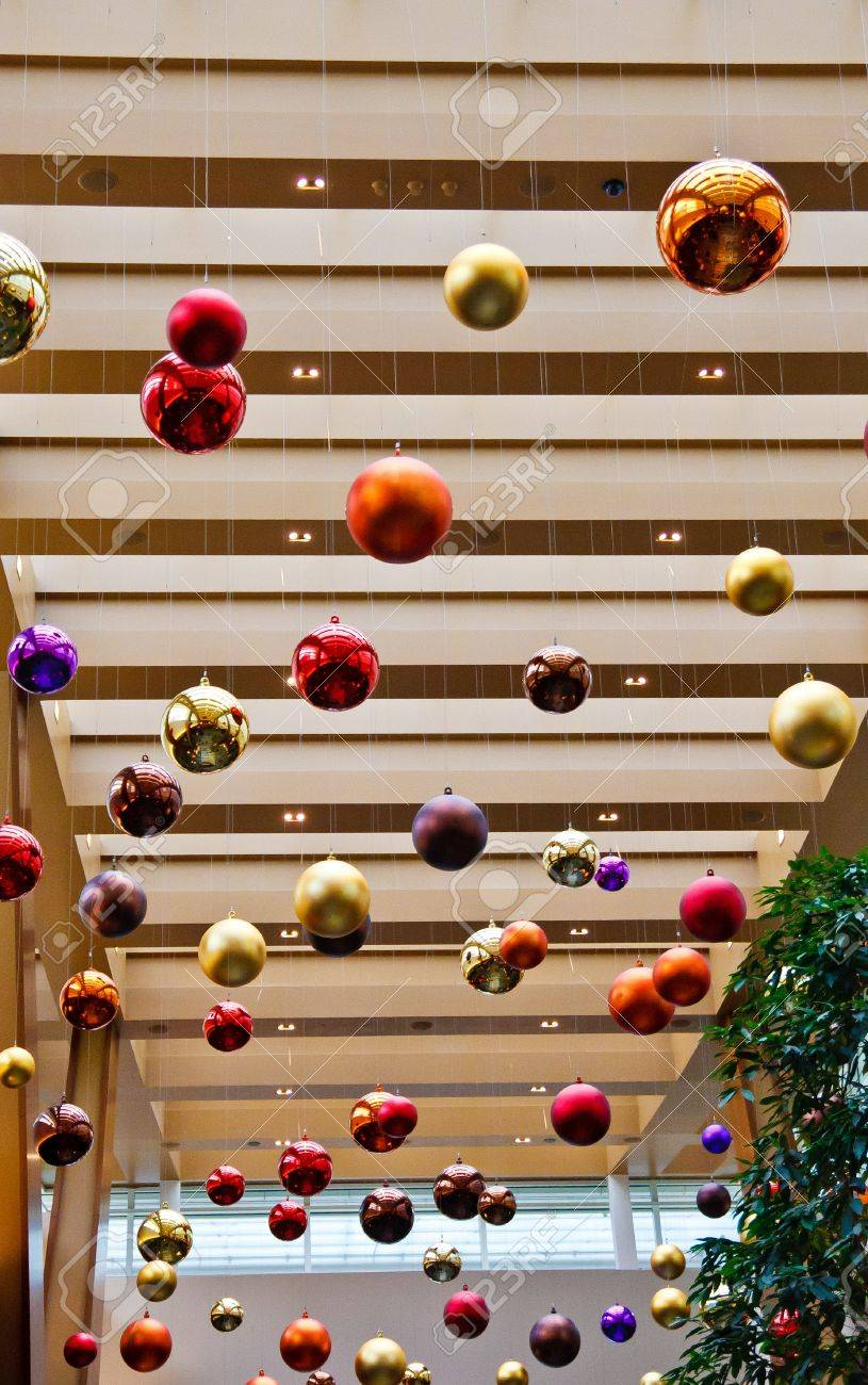 Hanging Christmas Decorations Ceiling.Colored Balls At Christmas Time Hanging From A Ceiling