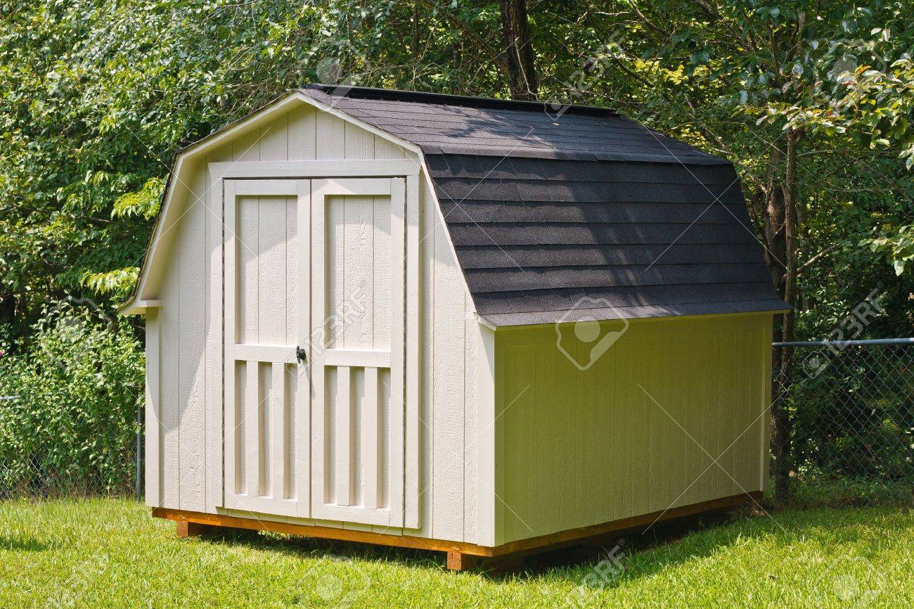 a wood utility shed in a back yard stock photo picture and