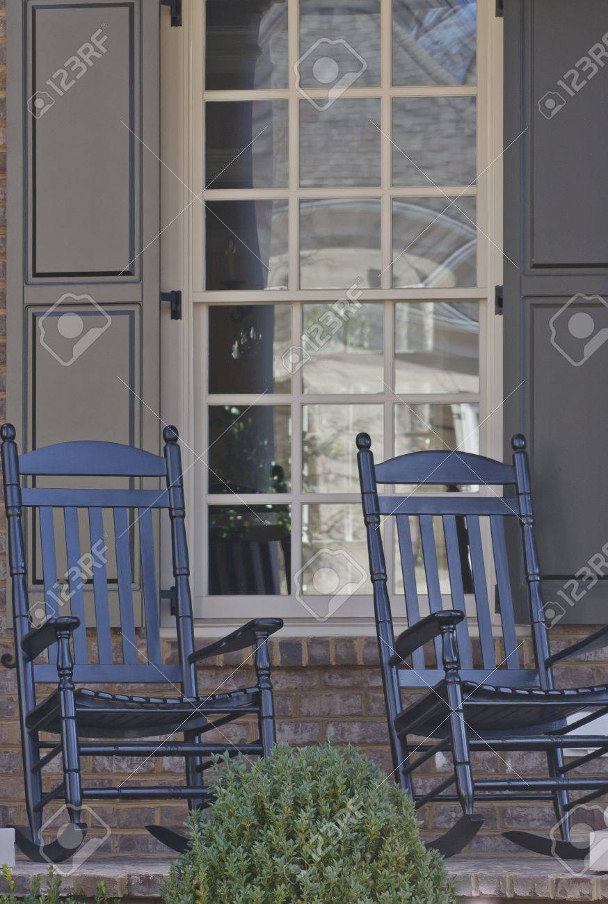 Peachy Two Black Rocking Chairs On A Residential Porch Bralicious Painted Fabric Chair Ideas Braliciousco