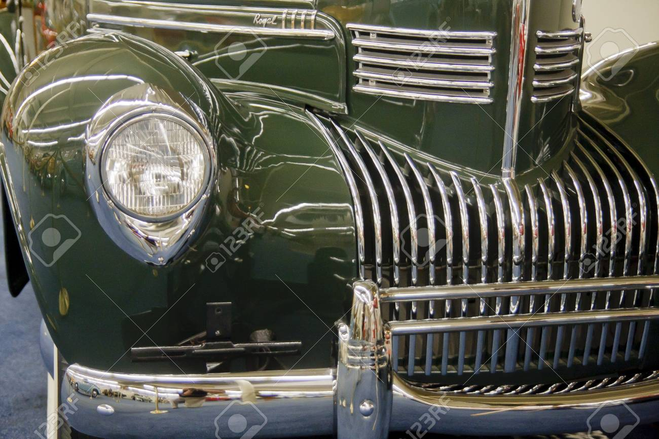 Front of an old green couple with chrome grill and bumper Stock Photo - 13037569