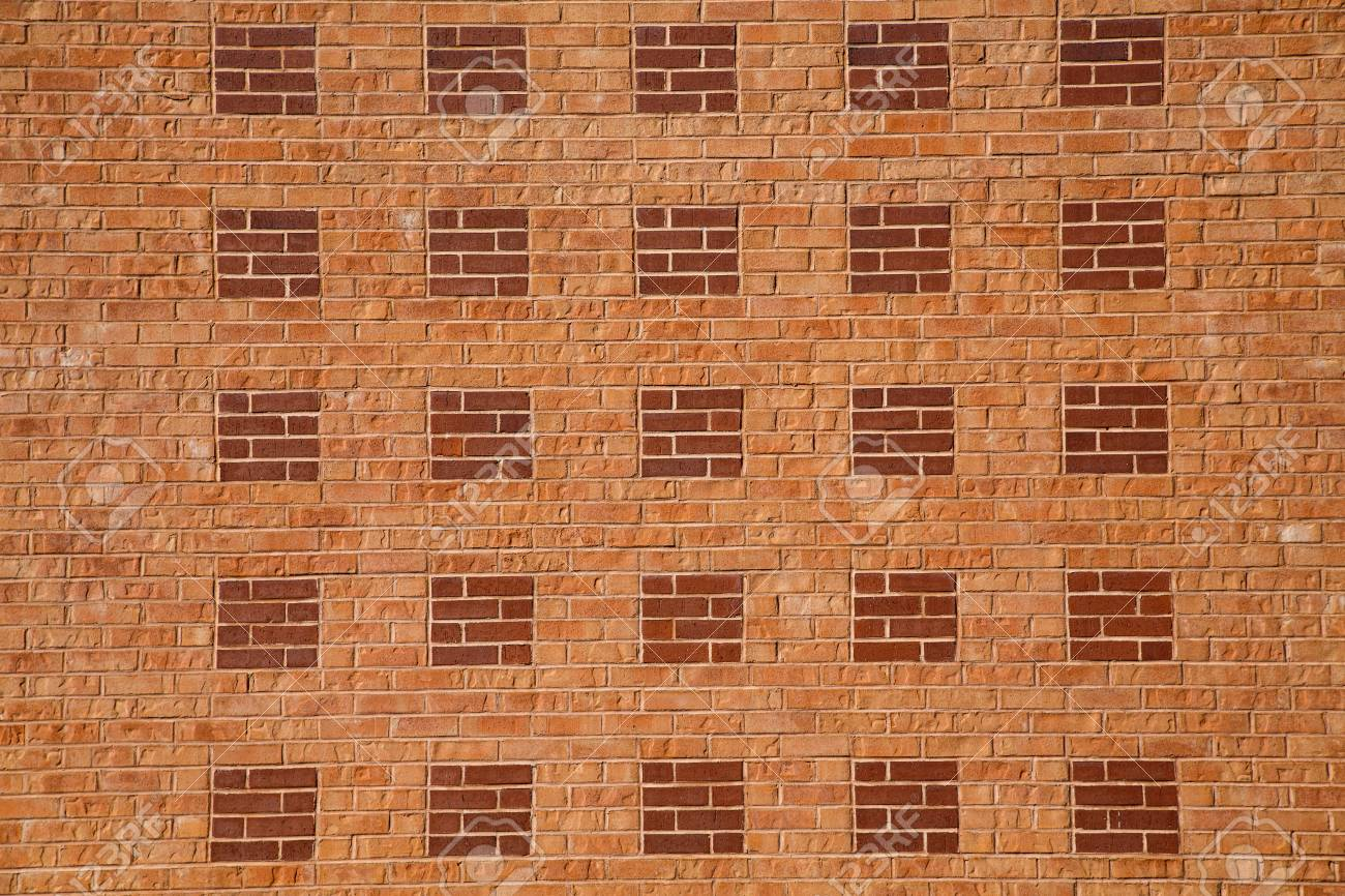 Light Red Brick Wall With Dark Squares For Background Or Textures Stock Photo