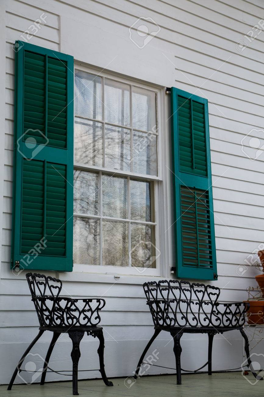 Fabulous Two Wrought Iron Benches On Porch Of White Wood Siding Home Under Ibusinesslaw Wood Chair Design Ideas Ibusinesslaworg