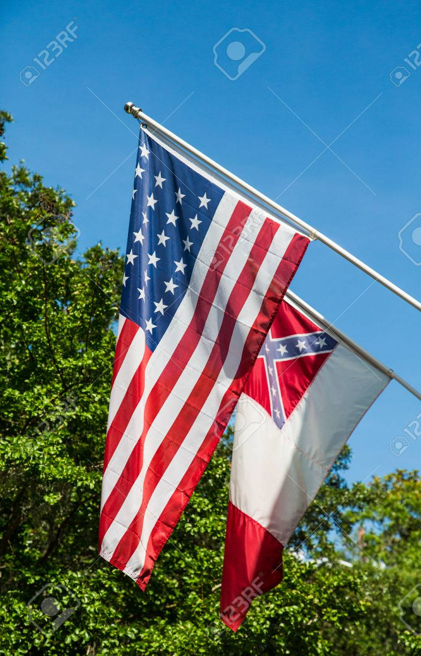 american flag with a flag of the confederate states on green stock