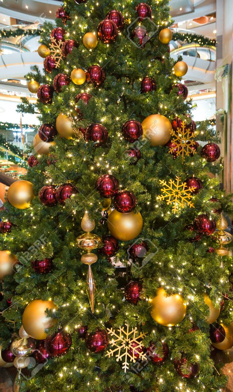 Many Red And Gold Ornaments On A Green Christmas Tree Stock Photo Picture And Royalty Free Image Image 33150984