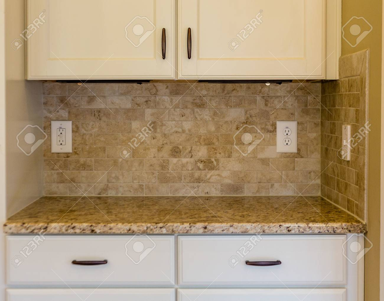 - Granite Countertops And Tile Backsplash On White Cabinets In