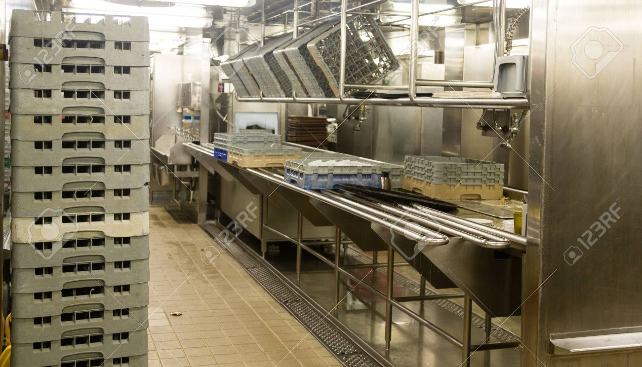 Modern stainless steel dishwashing equipment in a commercial..