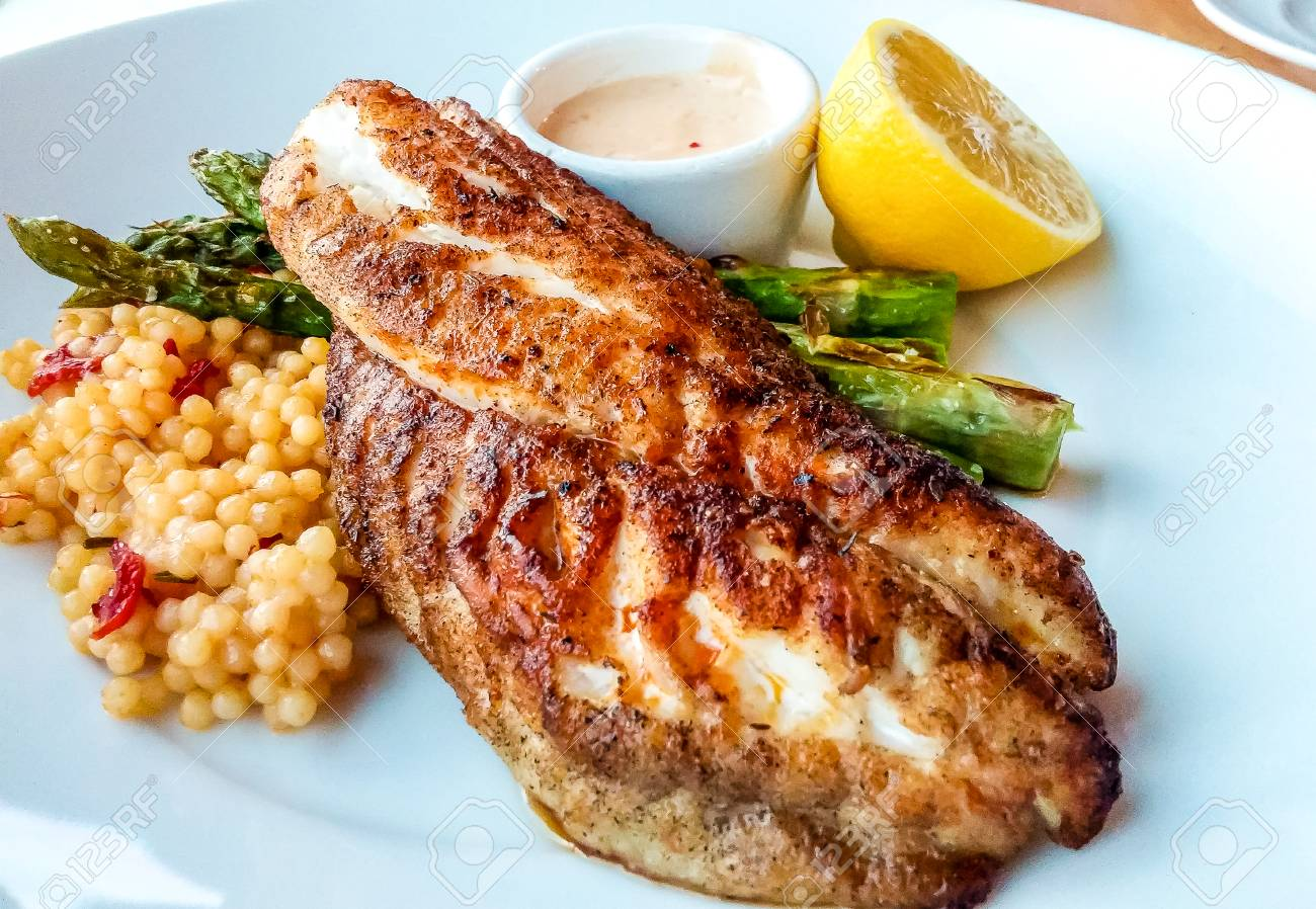 Blackened fish dinner with couscous asparagus and lemon - 54155031
