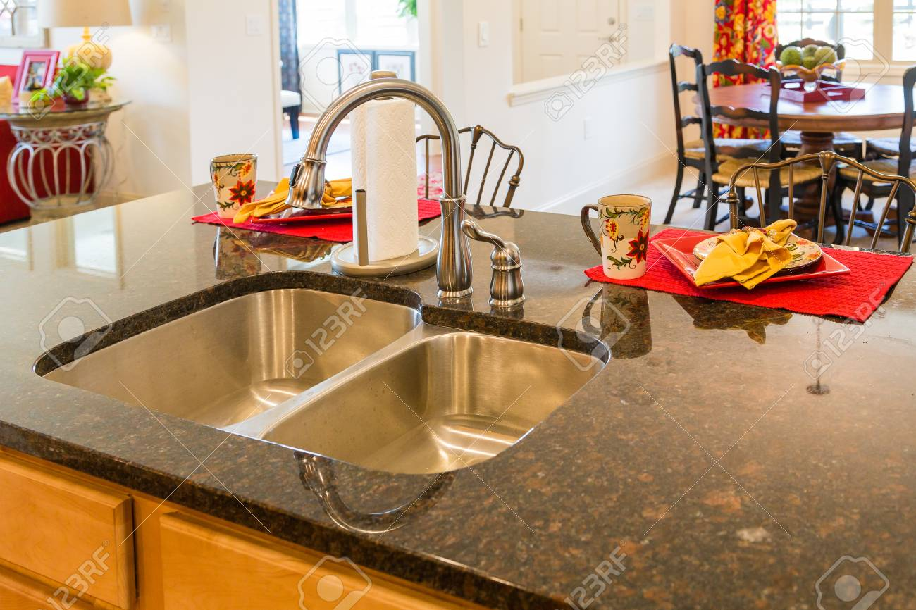 Stainless Steel Kitchen Sink And Fixture On Granite Countertop Stock Photo Picture And Royalty Free Image Image 60125781