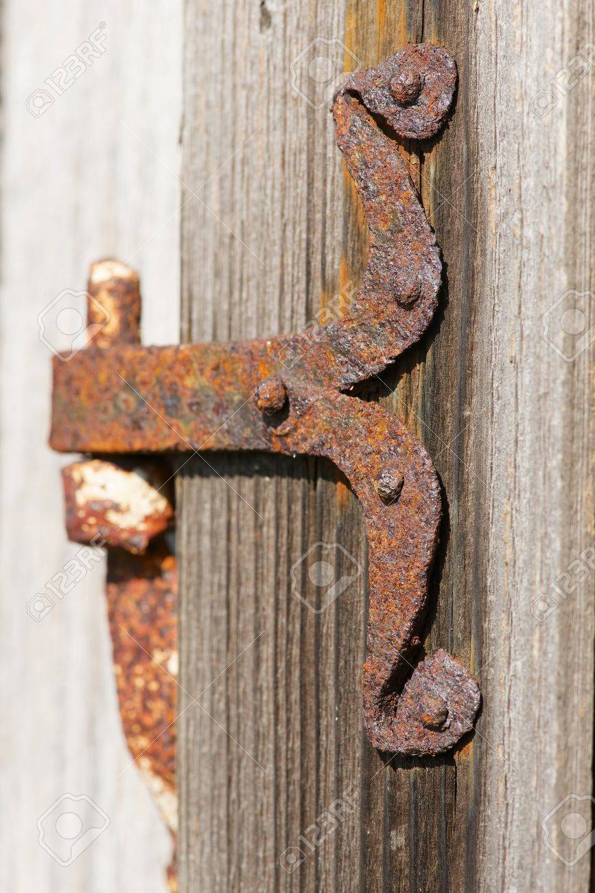 Stock Photo - Vintage rusted metal door hinge over the weathered wooden wall. & Vintage Rusted Metal Door Hinge Over The Weathered Wooden Wall ...