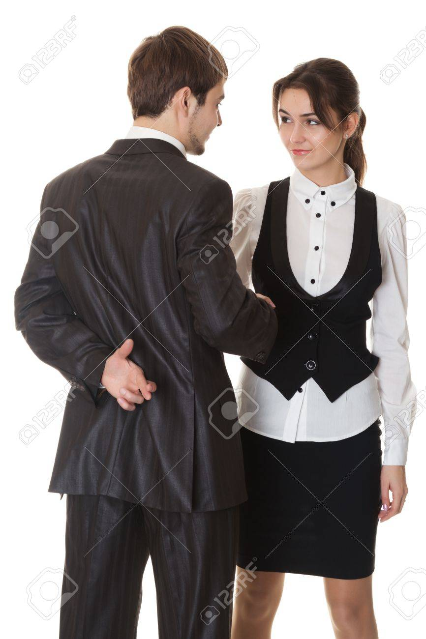 false deal, man and woman doing the handshake, the man crossed his fingers behind his back, isolated on white Stock Photo - 9824346