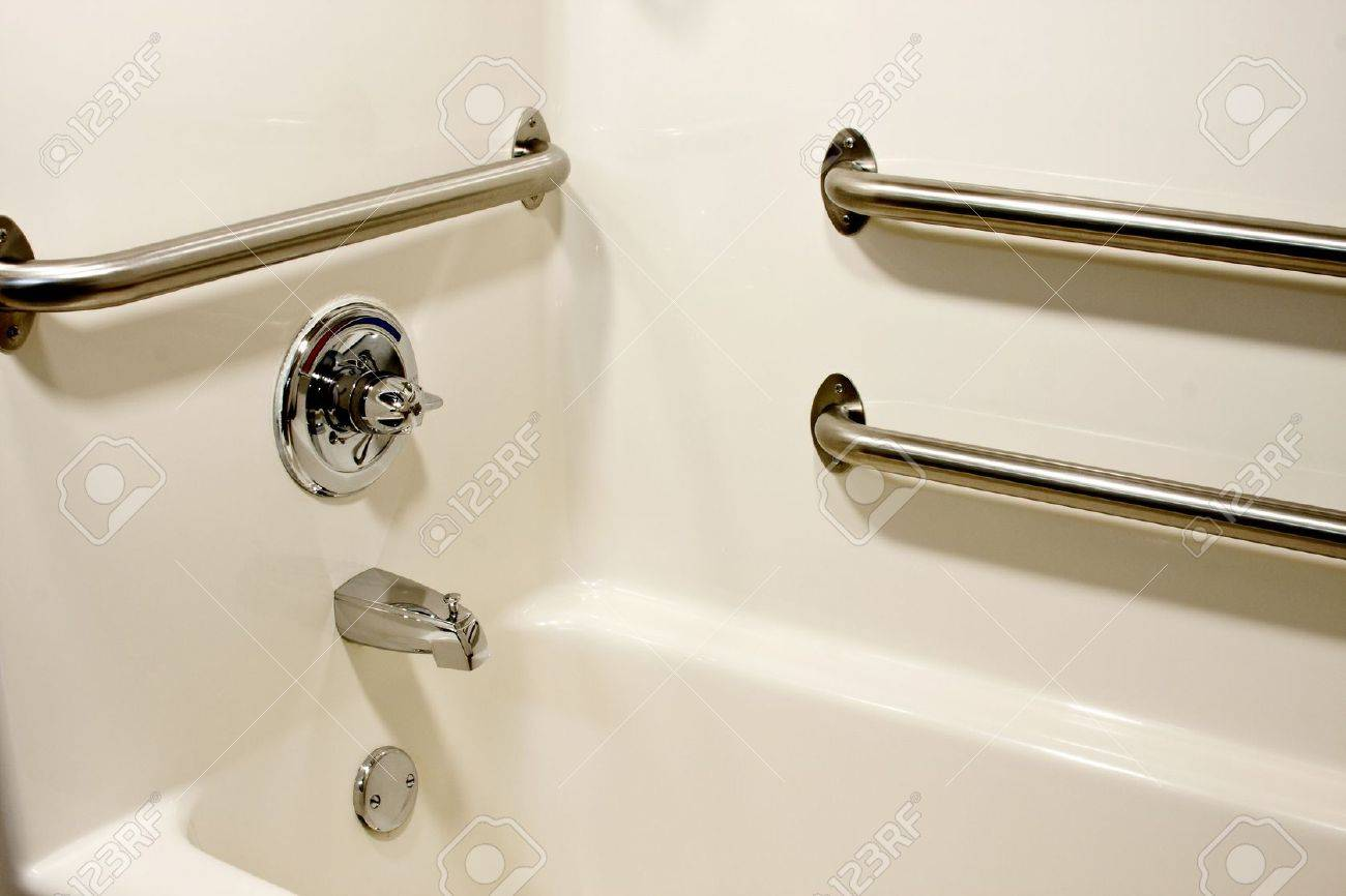 Stock Photo   chrome grab safety bars in a handicap bathtub. Chrome Grab Safety Bars In A Handicap Bathtub Stock Photo  Picture