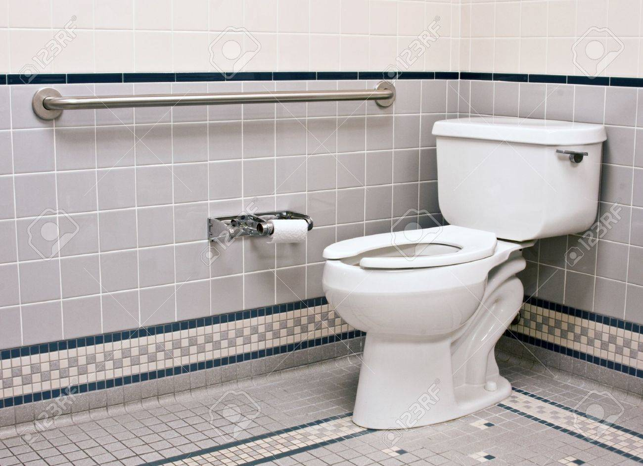 stock photo handicap bathroom with grab bars and ceramic tile
