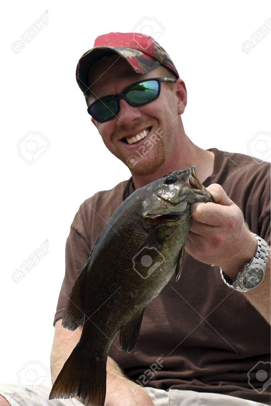 portrait of a happy fisherman holding a small mouth bass by the lip isolated over a white background with a clipping path at original size Stock Photo - 14597988