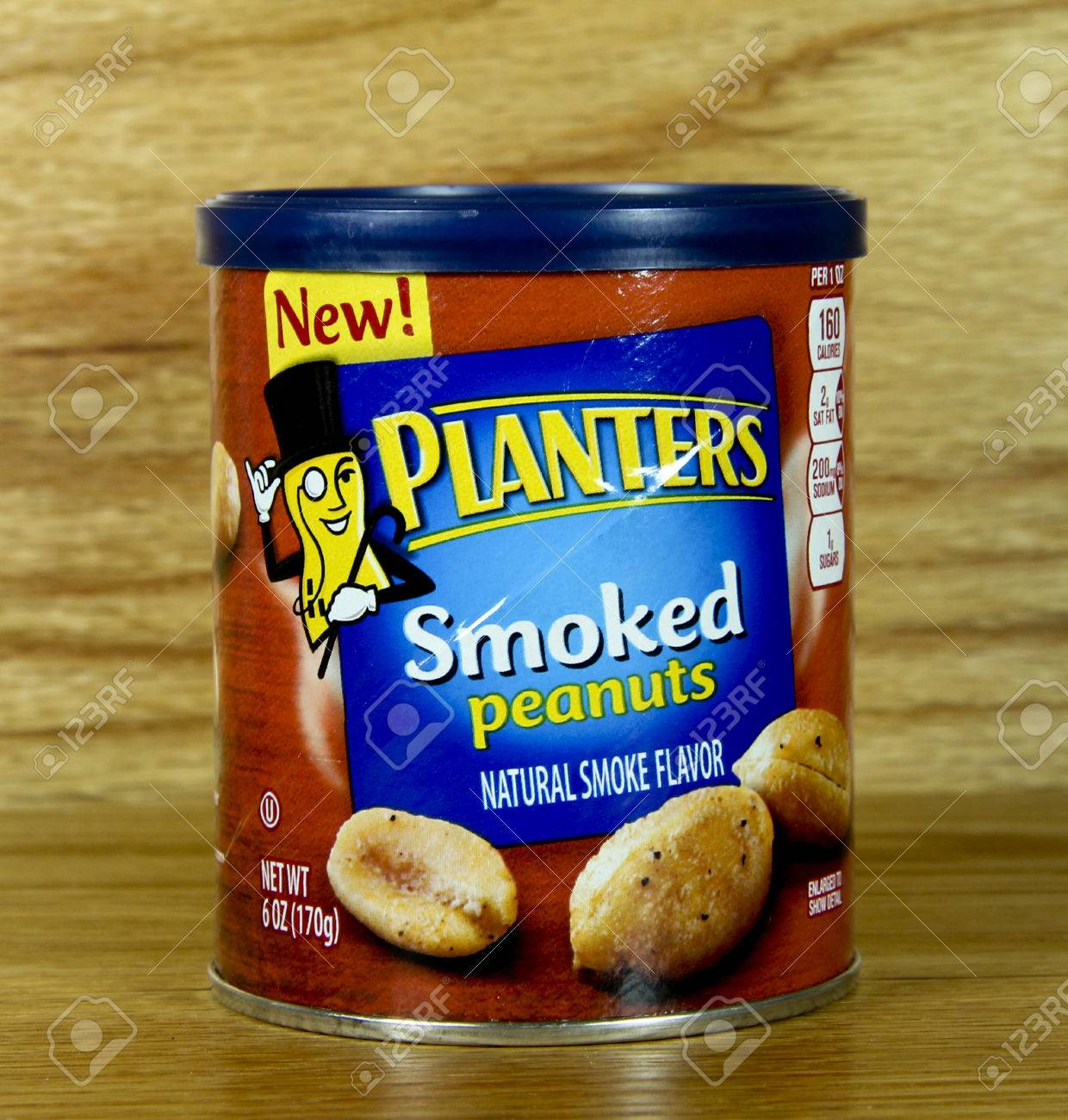 SPENCER , WISCONSIN June 22 , 2014: Can Of Planters Smoked Peanuts on smoked pineapple, smoked pork, smoked turkey, smoked tuna, smoked salt, smoked beef, smoked onions, smoked nuts, smoked bacon, smoked avocado, smoked eggs, smoked tomato, smoked almonds,