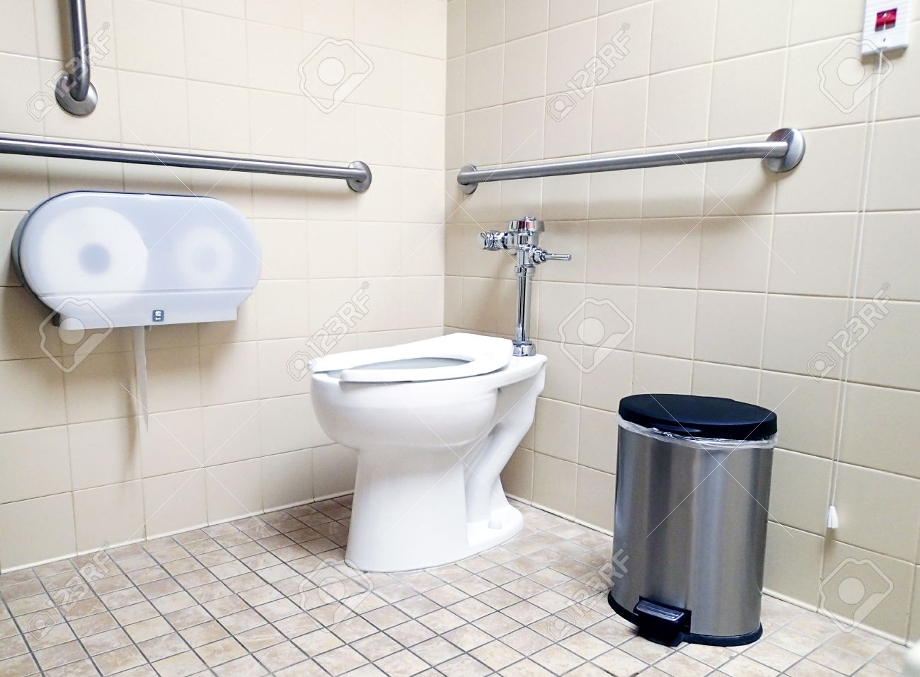 Modern Handicapped Bathroom For The Disabled, With Grab Bars And Wheelchair  Access. Stock Photo