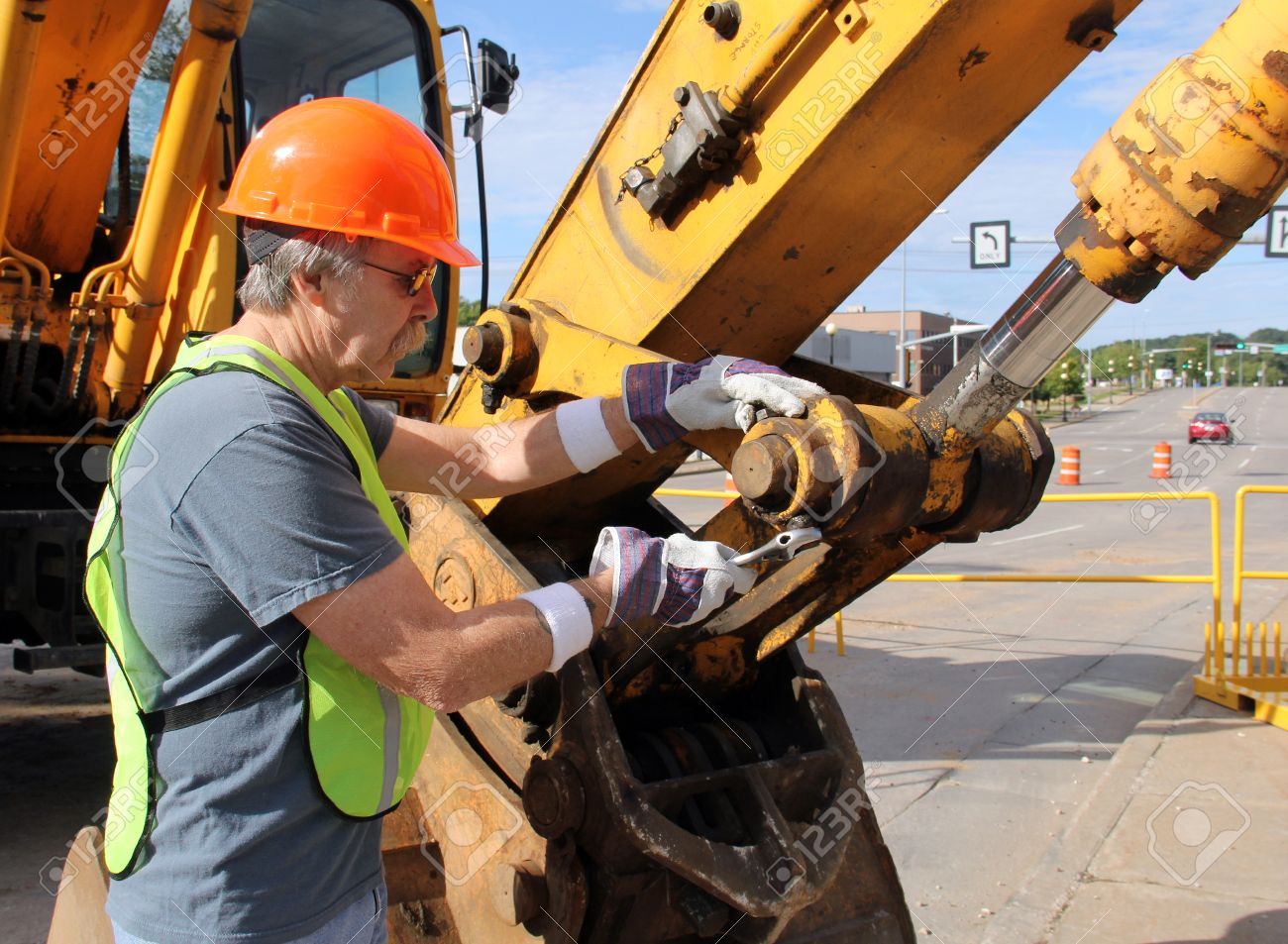 Heavy Equipment Mechanic Working With A Wrench On A Nut Stock ...