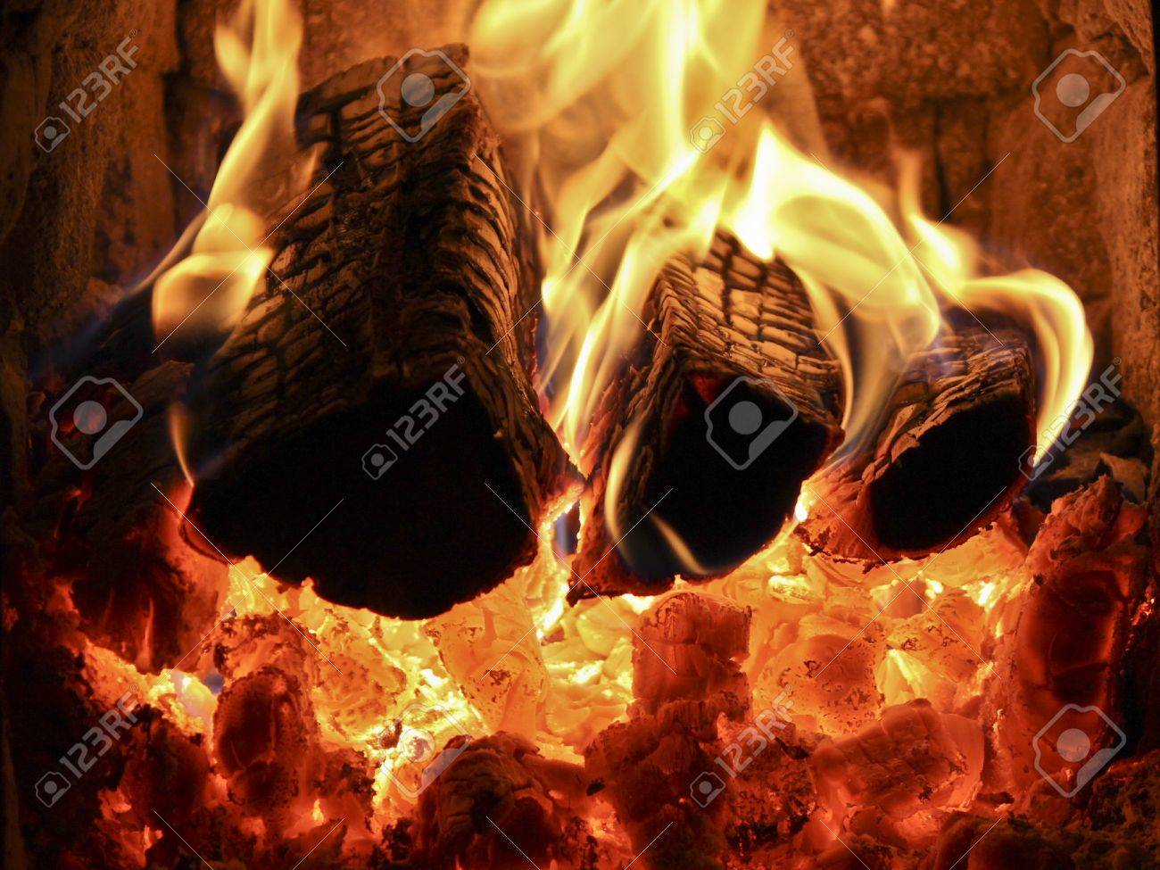 a fireplace with burning logs red coals and fire stock photo